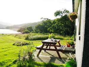 Self catering cottages overlooking Loch Teacuis Morvern on West Coast of Scotland